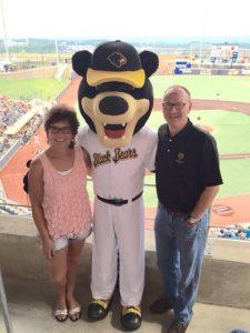 Peggy Lovio and David McCormick with Black Bears Mascot