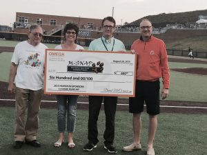 David and Peggy presenting MSNAP with the home run sponsor check at the Black Bears game.
