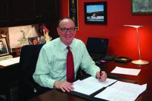 David McCormick at his desk at Omega Commercial Interiors