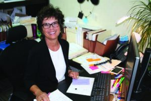 Peggy Lovio at her Desk at Omega Commercial Interiors