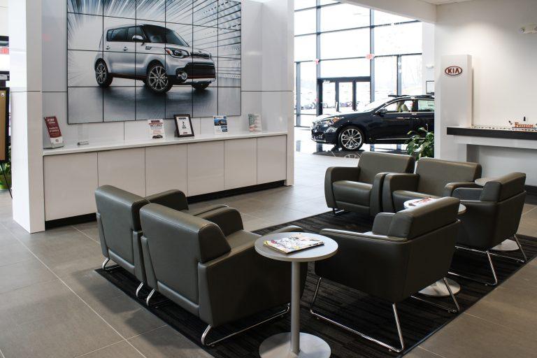 New Freedom KIA Lounge Area design by Peggy Lovio of Omega Commercial Interiors.