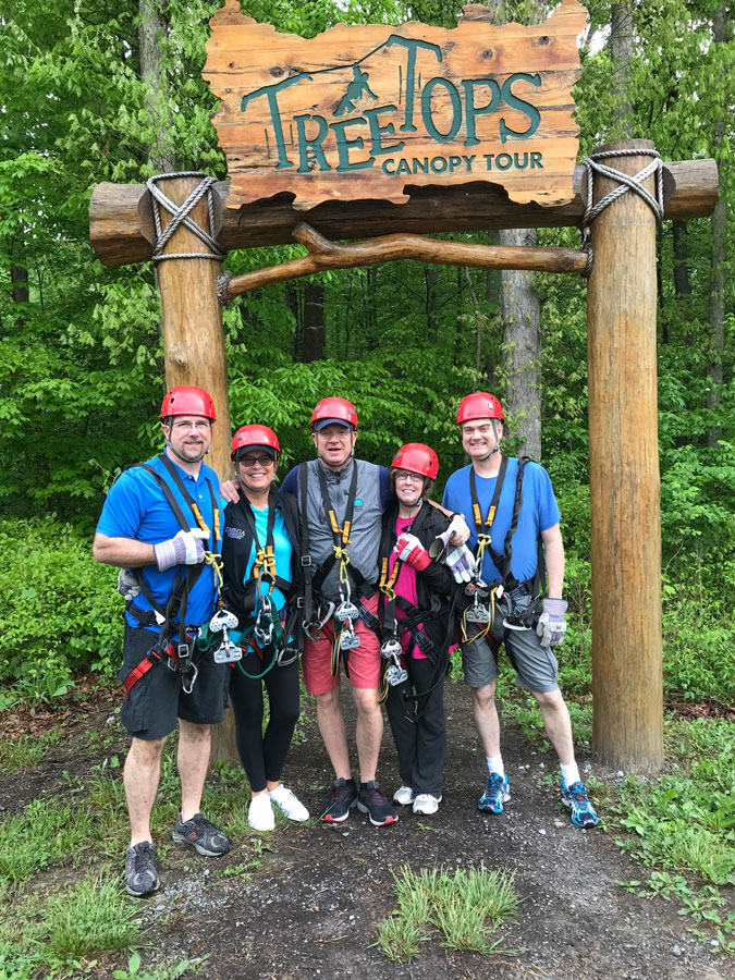 Leon, Peggy, David, LJ and Levi of Omega Commercial Interiors under the Treetops Canopy at the New River Gorge.